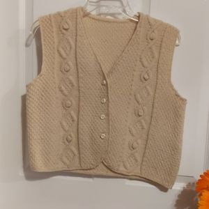 A knitted cream-colored crop vest